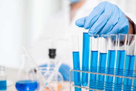 Medical scientists have experimented with liquid chemicals in vitro to analyze viral data in chemical laboratories. Scientific research concepts. Stock Photo