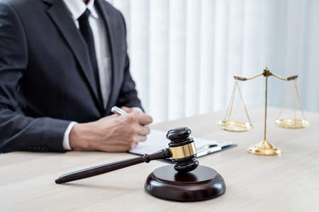 Judges gavel, Professional male lawyers work at a law office There are scales, Scales of justice, judges gavel, and litigation documents. Concepts of law and justice.