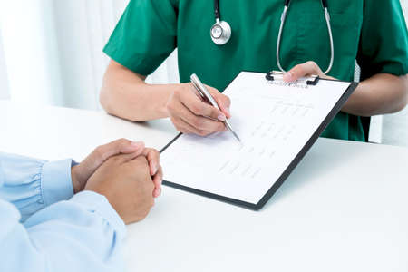 Male doctors explain and recommend treatment after a female patient meets a doctor and receives results regarding illness problems. Medical and health care concepts.