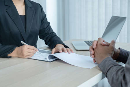Business people hold a resume and talk to job applicants for job interviews about careers and Her personal history in the company. Recruitment concepts.