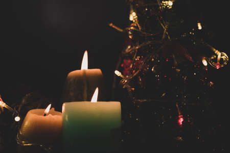 Focus on candles, a hundred thousand candles lit close tree Christmas new year's eve festival atmosphere welcome the new year.
