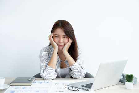 Working Asian women feel stressed, tired from work, migraine headaches from hard work while working at the office. Stock fotó