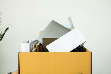 Dismissal concept. Cardboard boxes containing belongings On the table. Reklamní fotografie