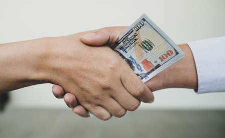 Corruption. Businessmen make an agreement with the money proposed his partner to bribe in the office and make a contract under an agreement. Illegal money fraud The concept of bribery and corruption. Reklamní fotografie