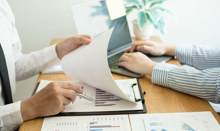 Two business leaders talk about charts, financial graphs showing results are analyzing and calculating planning strategies, business success building processes. Reklamní fotografie