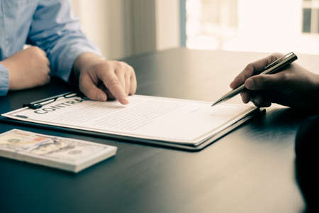 Corruption. Businessmen make an agreement with the money proposed his partner to bribe in the office and make a contract under an agreement. Illegal money fraud The concept of bribery and corruption.
