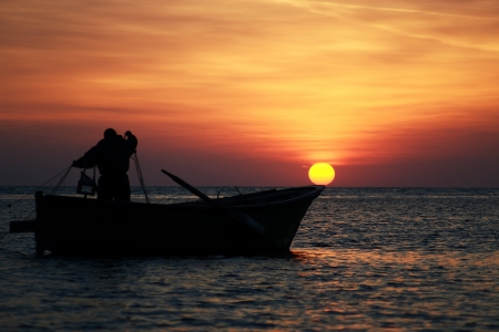 The Fisherman at sunset photo