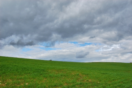 Hill with blue sky and clouds - 3 Stock Photo