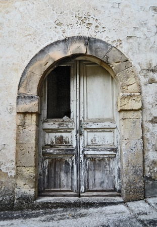 old door in stone archway photo