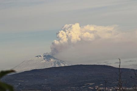 Etna erupting with ash column