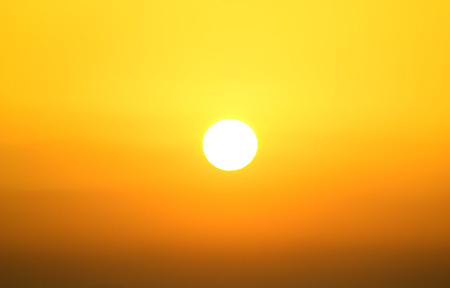 radiated: yellow sun at sunset Stock Photo