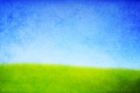 texture of a hill with green grass and blue sky Stock Photo