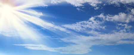 Beautiful blue sky with clouds and sun rays Stock Photo