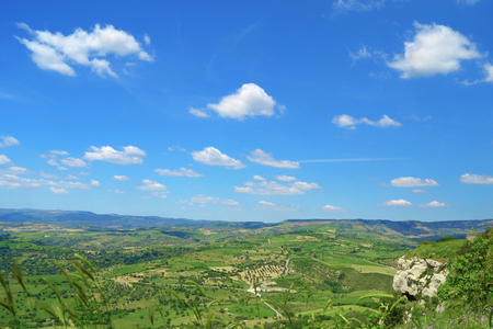 Fantastic green valley with clouds in the blue sky