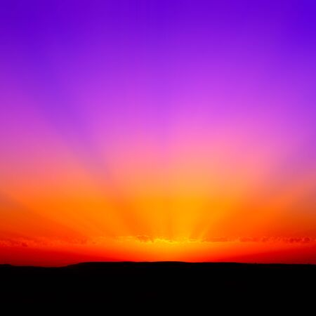 Sunset with shades of colors ranging from red to purple.