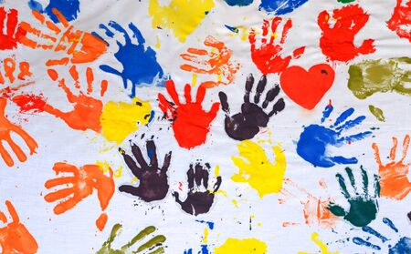 Hands colored red, yellow, orange and blue Stock Photo