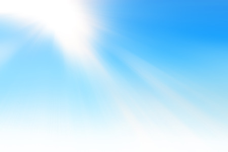 Rays of sun in the blue sky Stock Photo