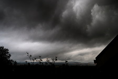 gray rain clouds. Dark stormy sky background