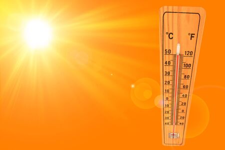 Sunny summer background with the thermometer marking a temperature over 50 degrees and bright sun on an orange background
