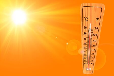 Sunny summer background with the thermometer marking a temperature over 45 degrees and bright sun on an orange background