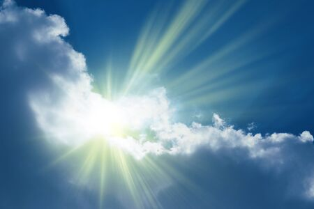 Sun rays sprouting through the clouds _ Paradise