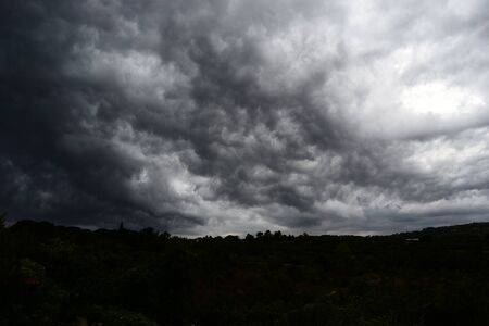 Thundercloud supercell seen from below, gray storm clouds