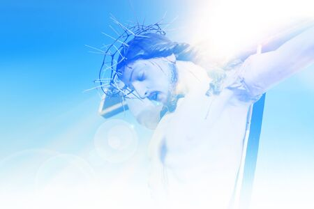 Jesus Christ on the cross against a background of blue sky Standard-Bild