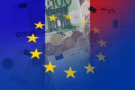 Flag of Europe and flag of France with euro notes and coins as a background