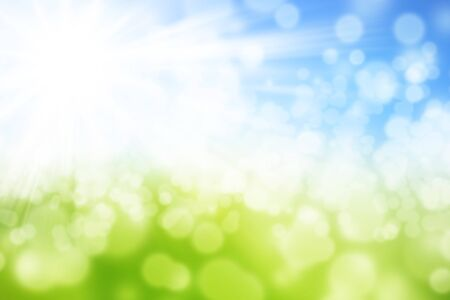 Green and blue blurred summer background with shining sun and with Bokeh