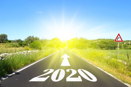 Highway with written 2020 with arrow and sun