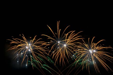 Colorful fireworks that explode and fill the darkness of the night sky with colored light. Imagens