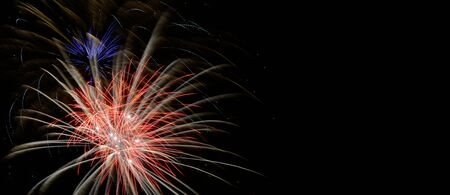 Colorful fireworks that explode and fill the darkness of the night sky with colored light.
