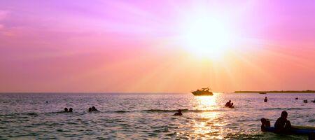 Purple and orange sunset over the sea.