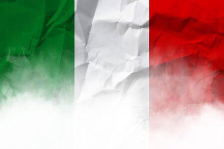 Italian national flag on crumpled paper.