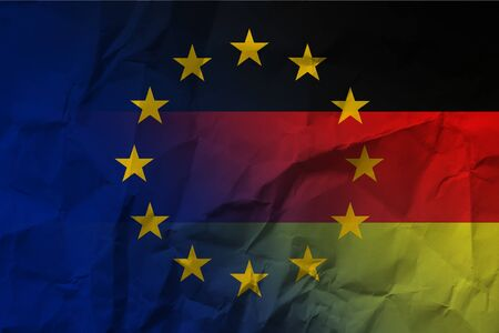 Europe Germany flag and banknotes on crumpled paper.