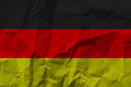 German national flag on crumpled paper.