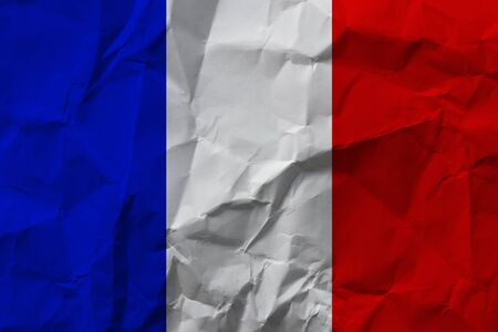French national flag on crumpled paper.