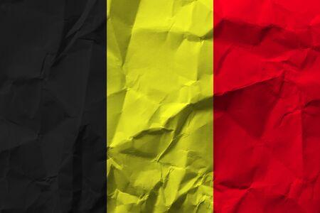 Belgium national flag on crumpled paper.