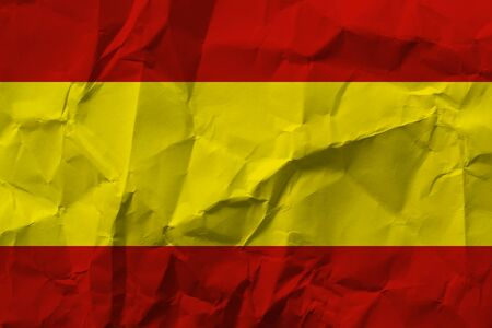 Spain national flag on crumpled paper.