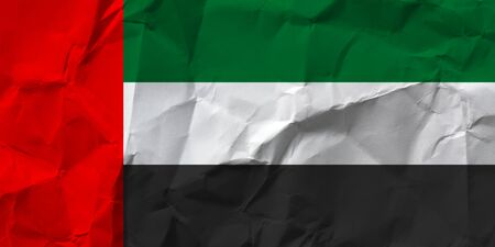 United Arab Emirates national flag on crumpled paper.