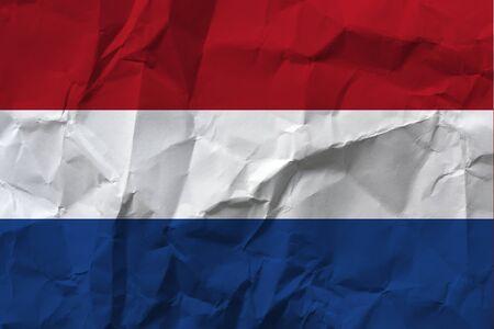 Netherlands national flag on crumpled paper.