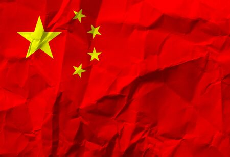 National People's Republic of China flag on crumpled paper. 版權商用圖片