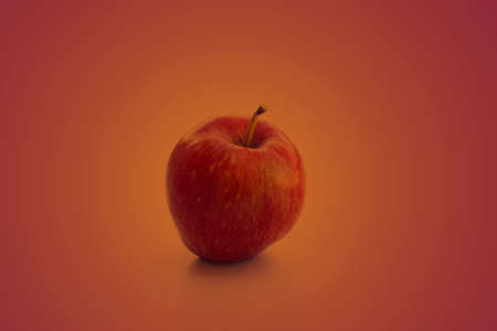 Beautiful red apple on a seamless superfood background