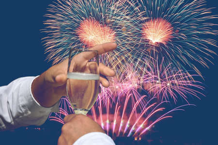 toast to the new year with fireworks Archivio Fotografico - 159256657