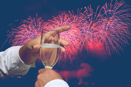 toast to the new year with fireworks Archivio Fotografico - 159256661