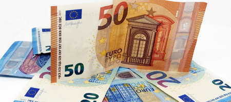 Euro banknotes.Pile of paper euro banknotes.Euro European currency - money.Euro cash background. Standard-Bild