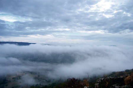 valley covered with mountain morning fog. Mist in the valley.