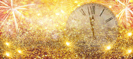 Fireworks New Year Clock.Countdown New Year's clock.Clock that marks a few minutes to the new year with torches and fireworks.