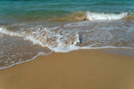 Foamy Wave On The Sandy Beach.Beautiful wave on the beach.
