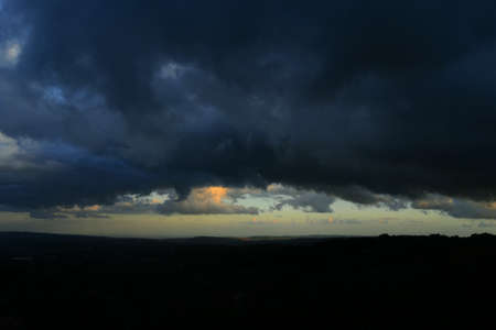 Big storm clouds. Nature Dark storm clouds, beautiful gray storm cloud. Time of the cataclysm. Stok Fotoğraf - 160590524